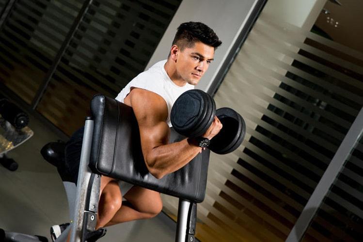man lifting dumbbell curl