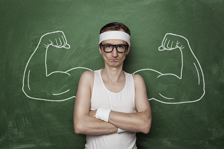 skinny guy who can't build muscle with big arms drawn on chalk board